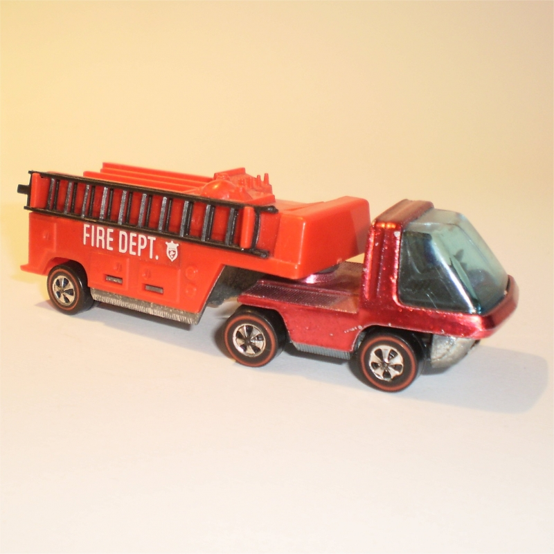 hotwheels heavyweights articulated moving van this one is in better