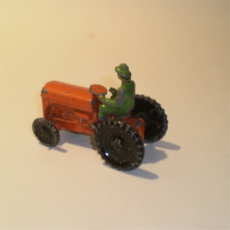 A small diecast tractor