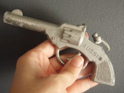 A Pope Product diecast toy hand gun
